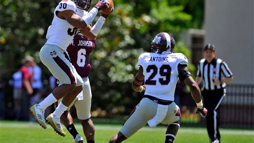 White defensive back Jay Hughes (30) intercepts a pass during the first half of Mississippi State's spring NCAA college football game, Saturday, April 20, 2013, in Starkville, Miss. (AP Photo/Austin McAfee)