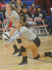 Cooper's Aubrie Flores lunges for a Wichita Falls Hirschi shot while Honna Turner looks on against Wichita Falls Hirschi. Cooper swept Hirschi 25-20, 25-16, 25-14 in the nondistrict match Tuesday, Sept. 19, 2017 at Cougar Gym.