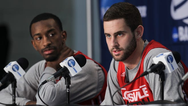 U of L's Luke Hancock, right, and Russ Smith answer a question during a press conference ahead of their NCAA matchup with Manhattan at the Amway Center in Orlando, Fl. Mar. 19, 2014