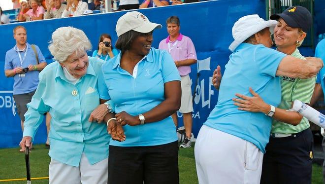 (From left) LPGA Founder Marilynn Smith, former player Renee Powell and Founder Shirley Spork congratulate Karrie Webb Sunday.