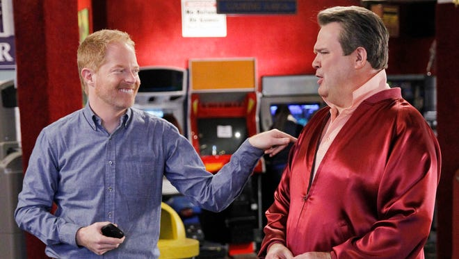 "Eric Stonestreet, as Cameron, right, and Jesse Tyler Ferguson as Mitchell in a scene from ""Modern Family."" Tonight's episode has Cam marrying Mitchell and their friend Pepper  planning the wedding."