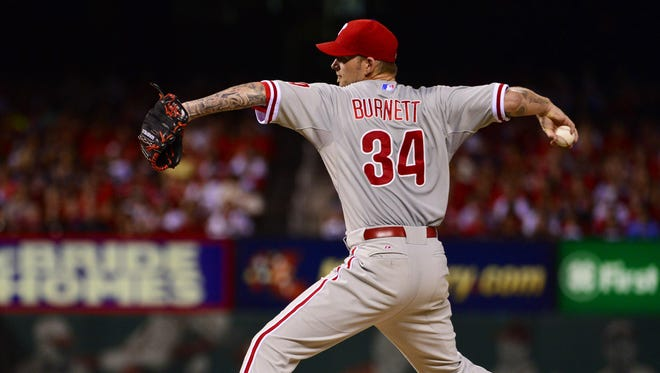 Philadelphia Phillies starting pitcher A.J. Burnett (34) delivers a pitch against the St. Louis Cardinals during the fourth inning at Busch Stadium.