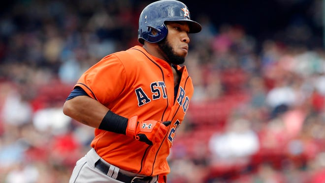 Houston Astros first baseman Jon Singleton rounds the bases after hitting a home run against the Boston Red Sox during the ninth inning at Fenway Park. The Astros defeated the Red Sox 8-1.