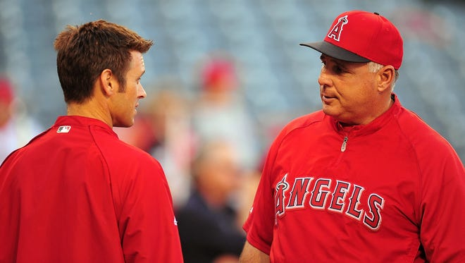 Angels manager Mike Scioscia and general manager Jerry Dipoto talked through their differences during multiple off-season meetings.