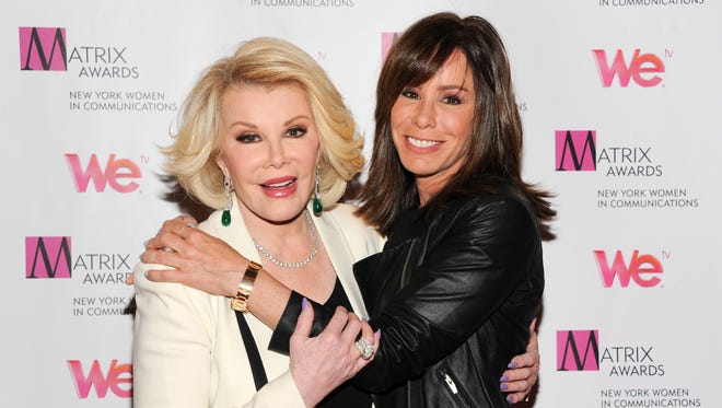 In this April 22, 2013, photo, Joan Rivers, left, and daughter Melissa Rivers attend the 2013 Matrix New York Women in Communications Awards at the Waldorf-Astoria Hotel, in New York.