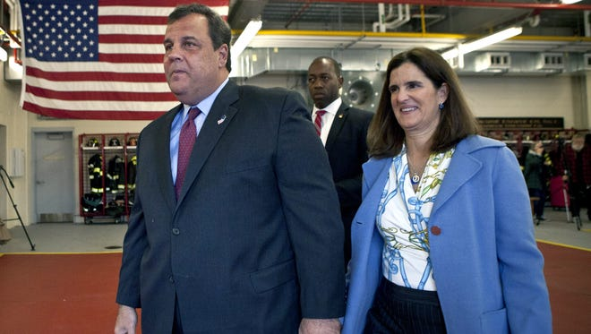 N.J. Gov. Chris Christie walks with his wife Mary Pat Christie after casting his ballot for New Jersey governor at a polling center at the Mendham Township Fire Department on Nov. 05, 2013, in Mendham, N.J.