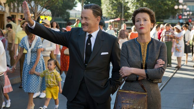 Tom Hanks as Walt Disney, left, and Emma Thompson as author P.L. Travers in a scene from 'Saving Mr. Banks.'