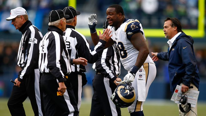 Rams defensive end Kendall Langford argues with referees after being ejected for making contact with an official against the Seattle Seahawks on Dec. 29, 2013.
