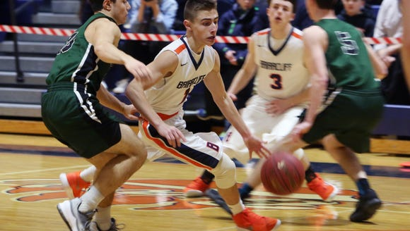 Briarcliff's Ross Lachtman (1) drives to the basket