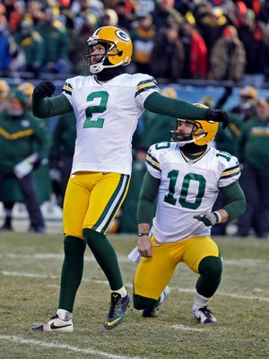 Green Bay Packers kicker Mason Crosby (2) watches his 32-yard field goal go through the uprights to win the game.