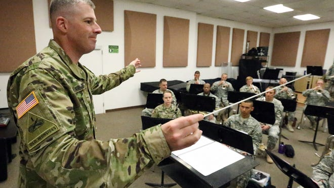 Capt. Richard Winkels has led the 1st Armored Division Band for the past 2 1/2 years. He will soon depart for the Middle East.
