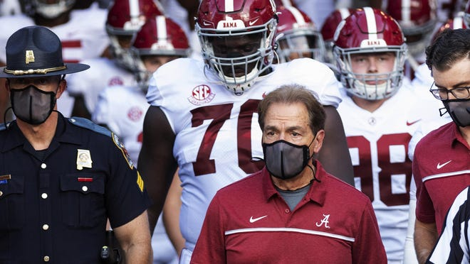 FILE - In this Sept. 26, 2020, file photo, Alabama coach Nick Saban leads his team to the field before an NCAA college football game against Missouri in Columbia, Mo. New Mississippi coach Lane Kiffin faces his old boss, Nick Saban, when the Rebels host No. 2 Alabama on Saturday. Saban last week improved to 20-0 when facing teams led by one of his former assistants. By