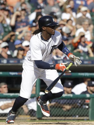 Detroit Tigers' Cameron Maybin runs to first during the eighth inning against the Kansas City Royals, Sunday, Sept. 25, 2016, in Detroit.