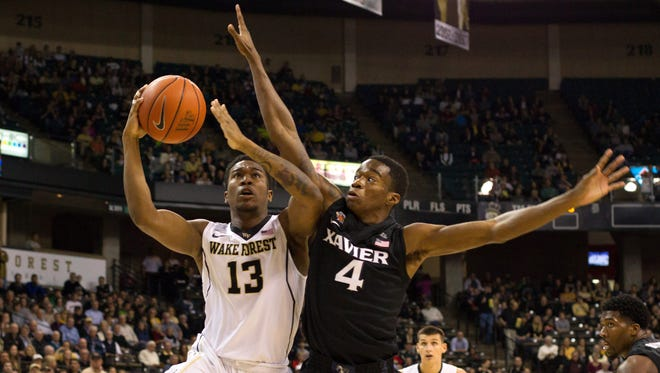 Wake Forest's Bryant Crawford goes up for a shot while Xavier's Edmond Sumner defends during the first half.