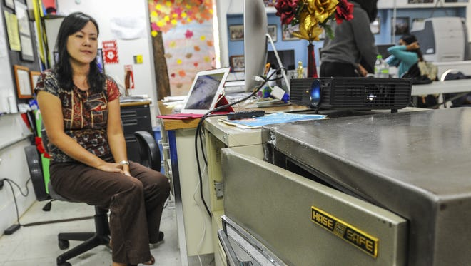 Amada Manzana, Guam Community College faculty who teaches marketing at Simon Sanchez High School, plays surveillance video on a tablet, on Nov. 10, which showed two suspects pushing a safe out from her classroom. School break-ins was a major reason lawmakers and education officials have pushed for the installation of security systems in Guam public schools. The installation process, by G4S, is expected to begin April 26.