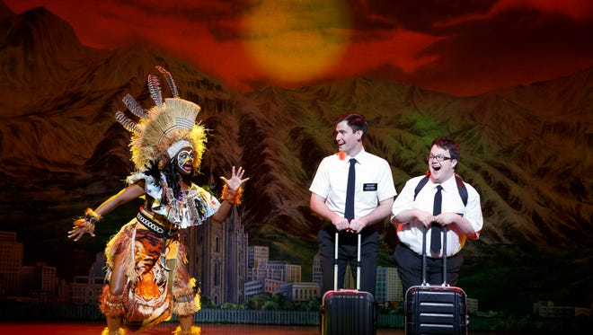 "Ryan Bondy (Elder Price), Cody Jamison Strand (Elder Cunningham) and Candace Quarrels (Nabulungi) in Broadway's ""The Book of Mormon."""