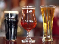 From left to right, Samuel Smith's Organic Chocolate Stout, Hopmouth from Acradia Ales and Carlsburg, are just a few of the beers served at Hopcat Brewery in Grand Rapids, Mich.