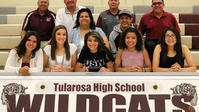 Tularosa senior Bethany Betancur, front center, signed her letter of intent to play basketball at University of Southwest on Thursday morning at the Michael Dorame Gymnasium.