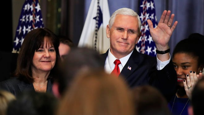 Vice President Pence with his wife Karen Pence, waves to anti-abortion supporters and participants of the annual March for Life event, during a reception in the Indian Treaty Room at the Eisenhower Executive Office Building  Thursday.