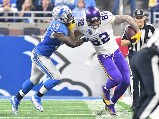Lions' Tahir Whitehead pushes Vikings tight end Kyle Rudolph, right, out of bounds in the fourth quarter.