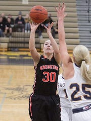 Brighton's Lauren Brown shoots while defended by Hartland's