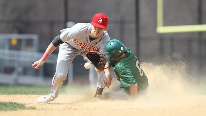 FDR's Brian Scheiner (6) slides in safe at second as North Rockland's Ken Hoppe (4) attempts a tag during varsity baseball action at FDR High School in Hyde Park on Saturday, April 15, 2017.  North Rockland won 7-2.