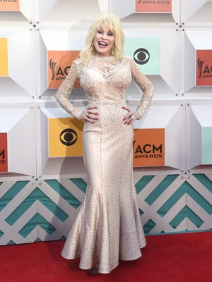 Dolly Parton arrives on the red carpet at the 51st Academy of Country Music Awards at Las Vegas MGM Grand Garden Arena Sunday April 3, 2016, in Las Vegas, NV.
