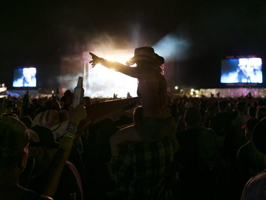 Fans watch Toby Keith perform during Country Thunder