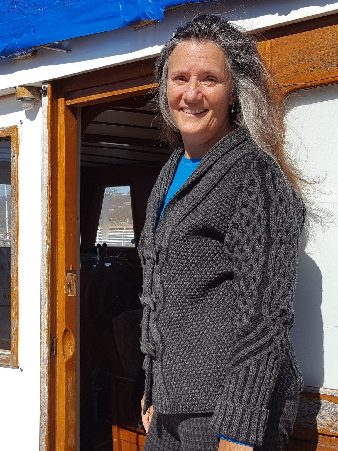 Pamela Wellumson poses for a photo on the boat she