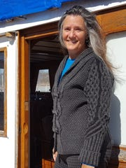 Pamela Wellumson poses for a photo on the boat she lives on in the Mississippi River, April 16, 2017.