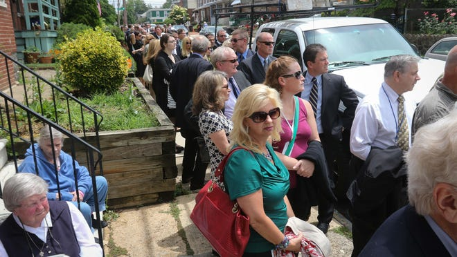 """Members of the public line West 10th Street from North Du Pont Street up to Claymont Street as they wait to pay their respects to Joseph R. """"Beau"""" Biden III at St. Anthony of Padua in Wilmington on Friday."""