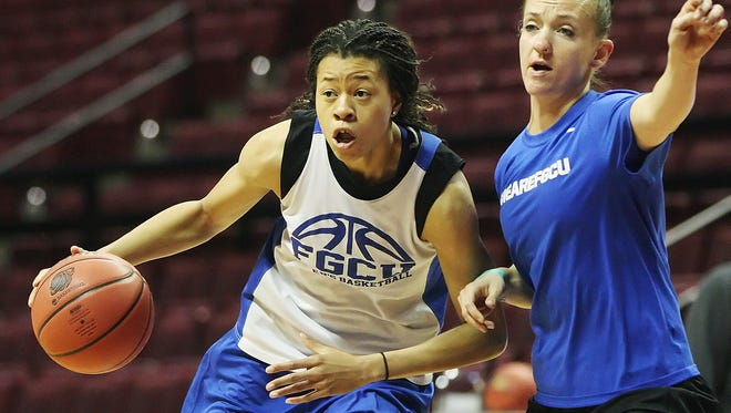 FGCU's Whitney Knight runs through drills with assistant coach Chelsea Dermyer during practices Sunday at the Donald L. Tucker Civic Center in Tallahassee. FGCU plays Florida State University on Monday in the NCAA tournament.
