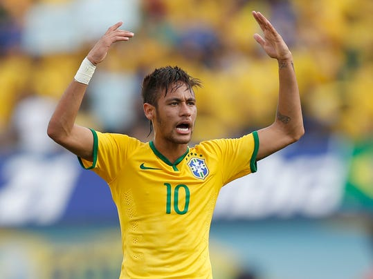 Brazil's Neymar celebrates after scoring against Panama during a friendly soccer match at the Serra Dourada stadium in Goiania, Brazil, Tuesday, June 3, 2014. Brazil is preparing for the World Cup soccer tournament that starts on 12 June. (AP Photo/Andre Penner)