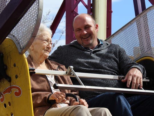 Helen Pumphery rides the Ferris wheel with Barry Cotton,