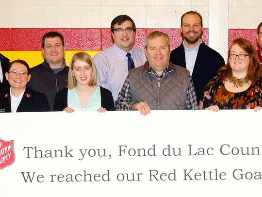 Community partners celebrate the $155,342.95 2015 Red