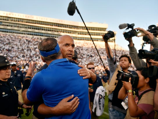 Penn State head football coach James Franklin greets