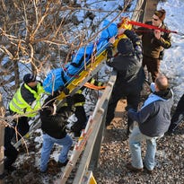 St. Cloud Fire Department, Stearns County Sheriff's Department and St. Cloud Police transport a body up the steep bank of the Mississippi River on Jan. 31, 2016, near the Granite City Crossing bridge on Minnesota Highway 23. This was the second body officials found in or along the river bank.