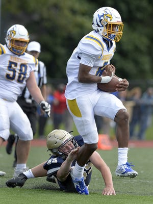 Irondequoit's Frederick June Jr., right, avoids a tackle by Brighton's Sam O'Hora during a regular season game at Brighton High School on Saturday, Sept. 9, 2017. Irondequoit beat Brighton 27-14.