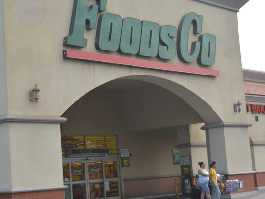 Customers walk out of the Tulare Foods Co Supermarket