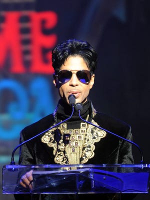 Prince announces concert dates at a news conference Oct. 14, 2010, at the Apollo Theater in New York.