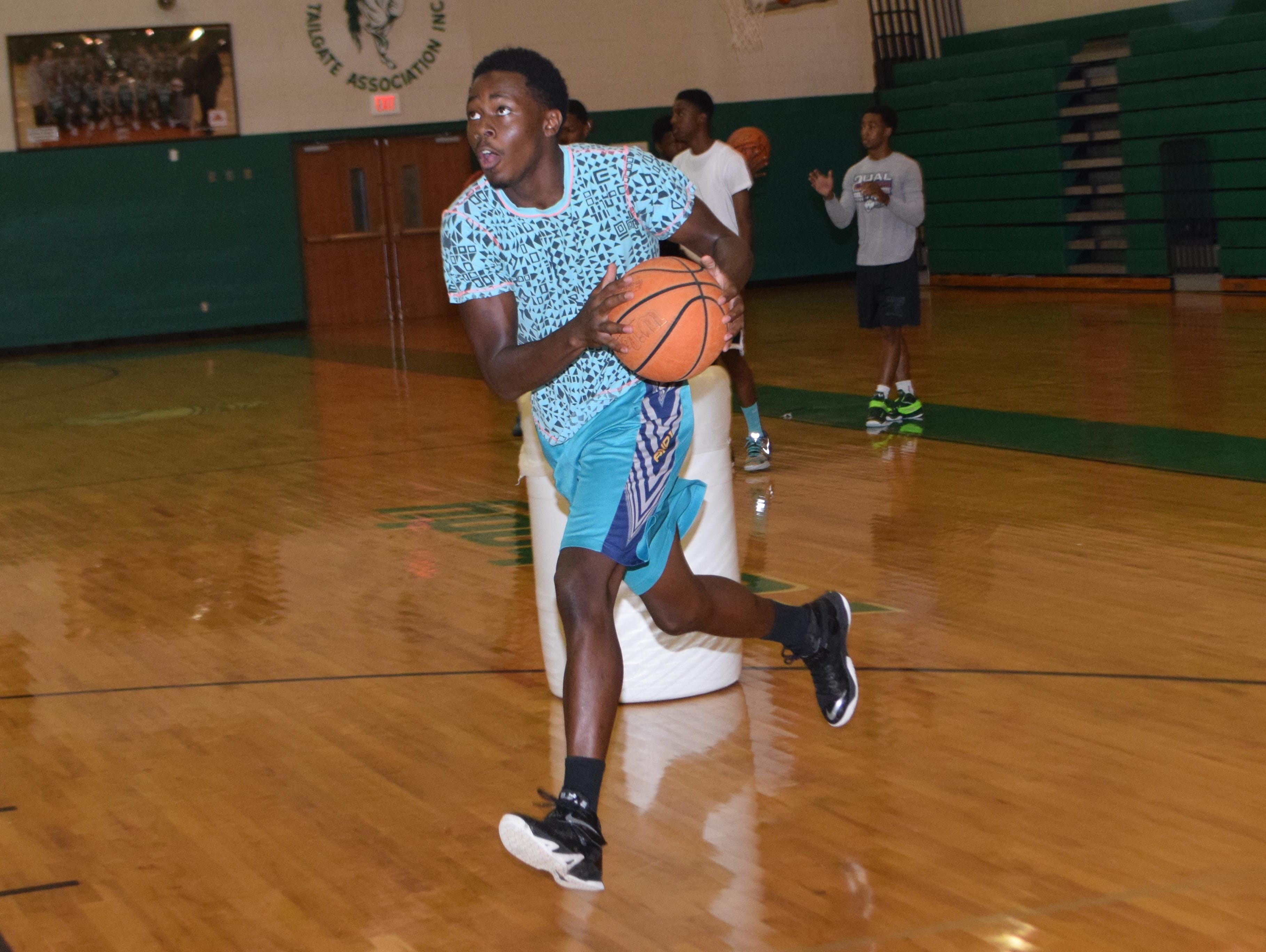 Peabody's Corey King practices with the rest of the Peabody team Wednesday. The Peabody Magnet High School basketball team recently won the Houston National Summer Showcase.