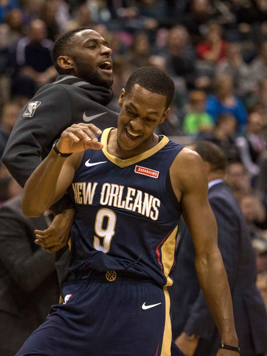 New Orleans Pelicans guard Rajon Rondo celebrates with a teammate after scoring a basket against the Milwaukee Bucks during overtime of an NBA basketball game Sunday, Feb. 25, 2018, in Milwaukee. The Pelicans defeated the Bucks 123-121 (AP Photo/Darren Hauck)