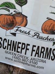A peach bag sits in the orchard during the Peach Festival