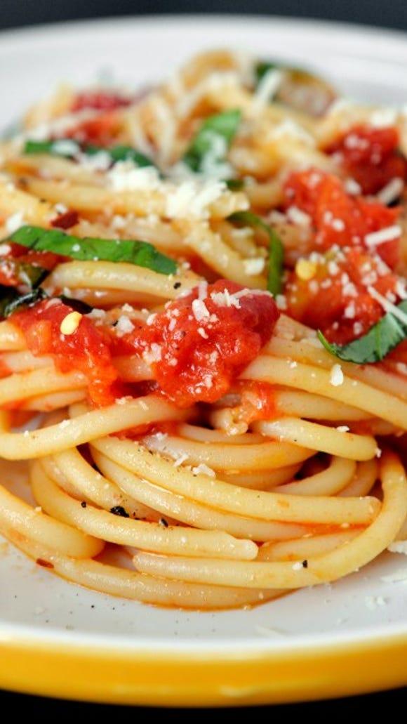 Bucatini with fresh tomato sauce and basil. Photo by Chris Dunn.