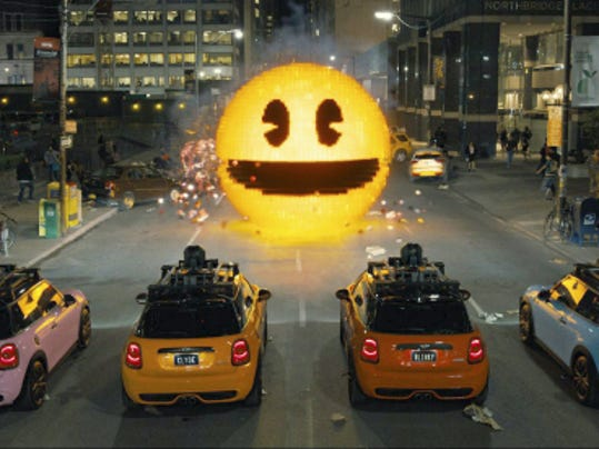 "This photo provided by courtesy of Sony Pictures shows, Inky, Blinky, Clyde and Pinky in Columbia Pictures' ""Pixels."" The movie opens in U.S. theaters on July 24, 2015."