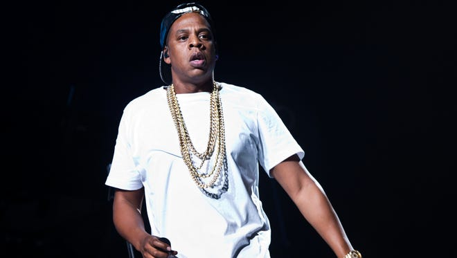 In this Oct. 10, 2013, file photo, Jay Z performs on stage at the O2 arena in east London, as part of his Magna Carta World Tour. Jay Z and Kanye West joined forces on March 12 during SXSW in Austin, Texas.