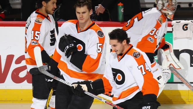 Samuel Morin, 50, and Mike Vecchione, 74, made their NHL debuts Tuesday night.