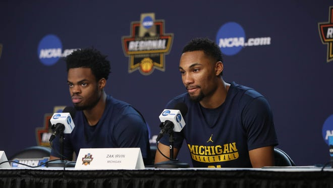 Michigan basketball players Derrick Walton Jr., left, and Zak Irvin talk with reporters March 22, 2017 at the Sprint Center in Kansas City, Mo.