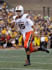 Brad Kaaya of the Miami Hurricanes celebrates after a touchdown against the Appalachian State Mountaineers during their game at Kidd Brewer Stadium on September 17, 2016 in Boone, North Carolina.