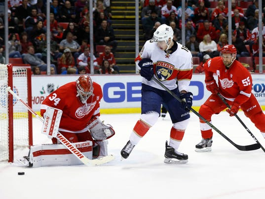 636162263242176318-AP-Panthers-Red-Wings-Hockey.jpg